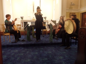 Josie Ryan as Jeanne d'Arc, with Brooke Green, vielle, Catherine Upex, bass viol, Jacques Emery, bodhran
